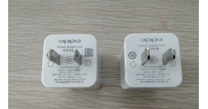 中國媒體實際拆了從「拼多多」網站買來的超便宜「原廠」手機電源充電器,看看裡面的元件有多黑心
